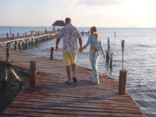 A romantic stroll down the Sueños Pier where our private table awaits